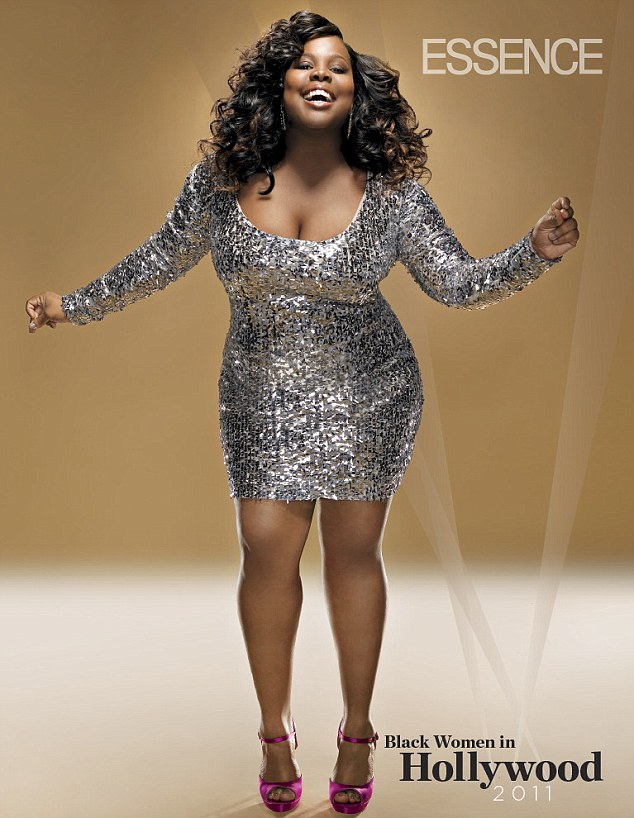Dazzling: Amber Riley models a sparkling silver dress for Essence magazine's Black Women in Hollywood issue