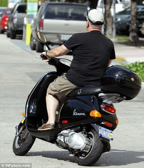 Unprotected: The 61-year-old later speed off without wearing any helmet or protective gear