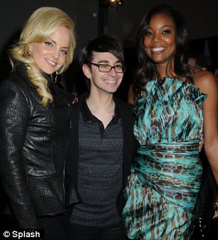 Celebrity fans: Siriano (centre) with Mena Suvari (left) and Gabrielle Union (right) backstage after his show