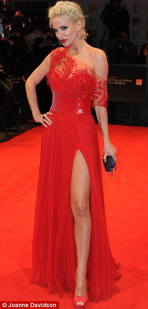 Scarlet fever: Sarah Harding made sure to turn heads at the Baftas in a bright red dress with a thigh-high split and matching peep-toe heels