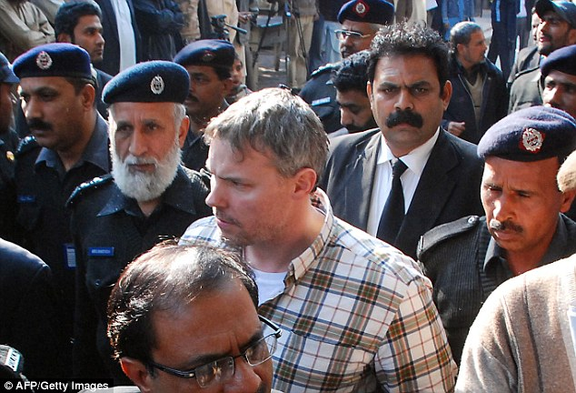 Mystery: Intrigue surrounds Davis, shown here in Lahore in January, amid unanswered questions about why the U.S. is willing to risk a diplomatic row with its biggest partner in the war on terror to get him back
