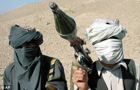 Face-covered militants who they say are Talibans pose with an RPG in Zabul province, southern of Kabul, Afghanistan