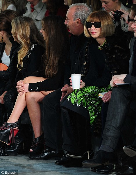 Paying attention: While Chloe and Sir Philip smile in pleasure at the show, Ms Wintour coolly observes the designs from behind her trademark dark sunglasses