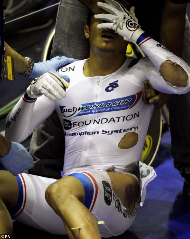 Unbearable: Awang tried to control his pain at the Velodrome