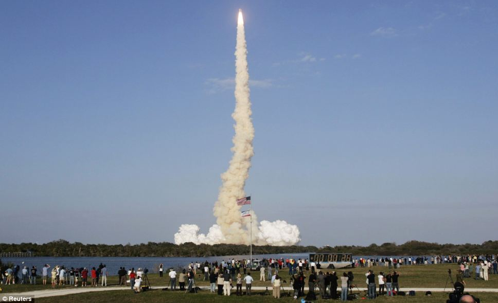 How it looked from the ground: Thousands gathered at Cape Canaveral to witness Discovery's last journey