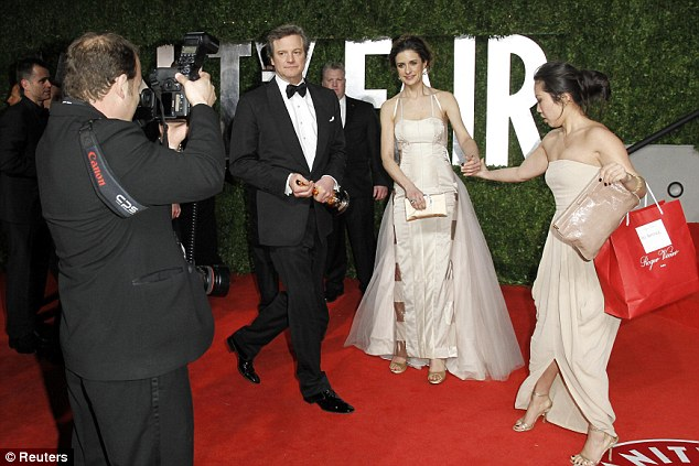 Hot ticket: Colin Firth arrives with his Best Actor Oscar and wife Livia Giuggioli