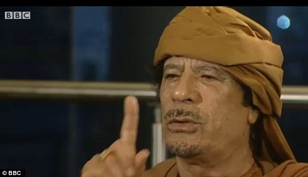 Delusional: Gaddafi showed no sign of quitting last night as he told reporters: 'They love me, all my people love me. They would die to protect me'