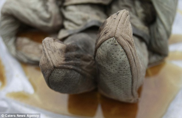 Wonderfully preserved: This close up of the mummy's shoes shows how well preserved her corpse it