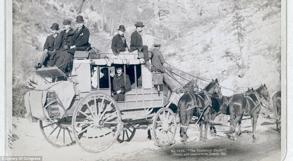 Modern travel: The photograph taken by John C.H Grabill in the 1880s was titled 'The Deadwood Coach' and shows formally dressed passengers both on top and inside