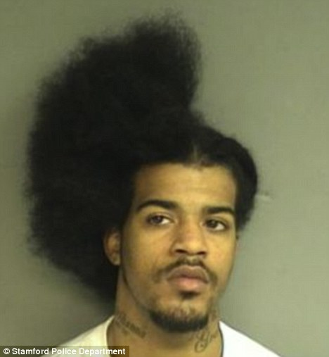 Half-cut: David Davis, of Newhaven, Connecticut, fled a barber shop after attacking a fellow customer with scissors, police allege