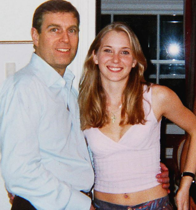 Revelation: Prince Andrew puts his arm around 17-year-old Virginia Roberts at Epstein's house in 2001. At the time, she was being exploited by Epstein, 58