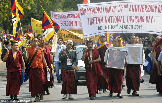 March: Buddhist monks were also out on the streets of Delhi to call for the liberation of Tibet