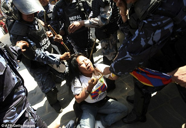 Protests: There were scuffles in the Nepalese capital Kathmandu as Dalai Lama supporters marked the annivesary