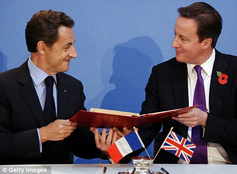 Agreement: Mr Cameron and Mr Sarkozy have demanded immediate action to tackle Gaddafi