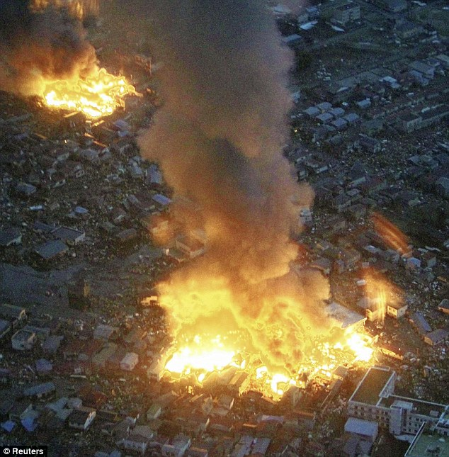 White hot: Two fires glow like molten lava amid the devastated houses in Yamada town