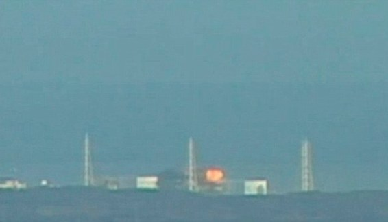 Fireball: A build-up of hydrogen in Unit Three of Fukushima ignites in a ball of fire that can be seen for miles