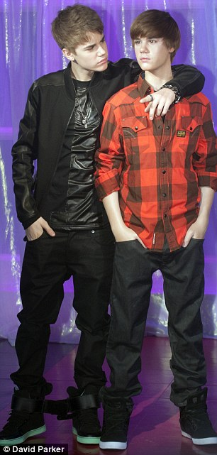 Spot the difference: Bieber labelled the waxwork 'awesome' and admitted it was funny to see how much he has grown in eight months