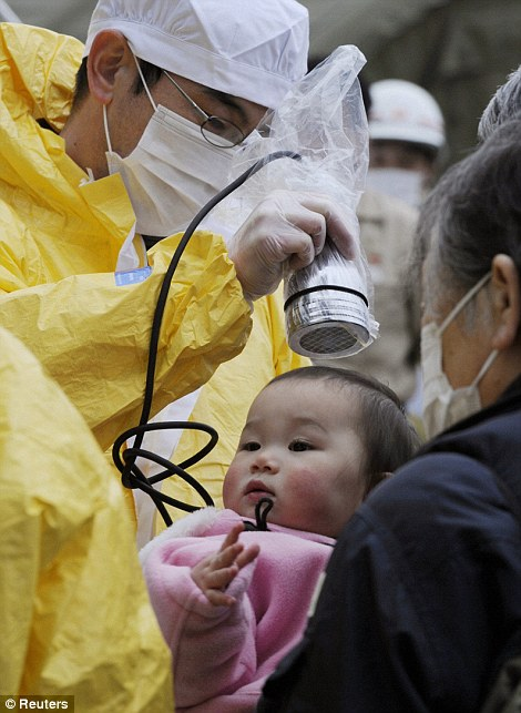 A baby is tested for radiation in Nihonmatsu