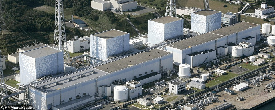 Intact: the four reactor buildings at the Fukushima Dai-ichi plant before the blast. Three of the buildings have blown up and there was a fire at the other
