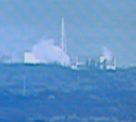 A cloud of white smoke cam be seen rising from the nuclear power plant