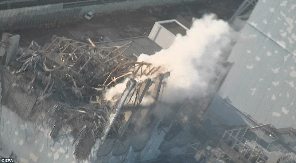 Wreckage: Radioactive steam rises from reactor number three of the Fukushima nuclear plant. It was severely damaged by an explosion