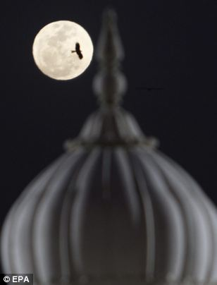 View of a full perigee moon in the backdrop of a minarette of a mosque, over Karachi city, Pakistan