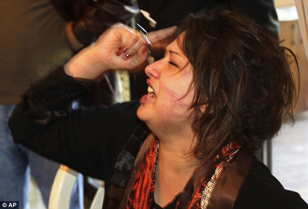 Distraught: Iman Al-Obeidi, claimed she had been gang-raped by Gaddafi's troops and detained for two days