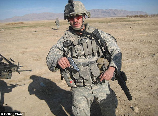 Gun: Corporal Jeremy Morlock with the pistol found at the scene of a helicopter strike