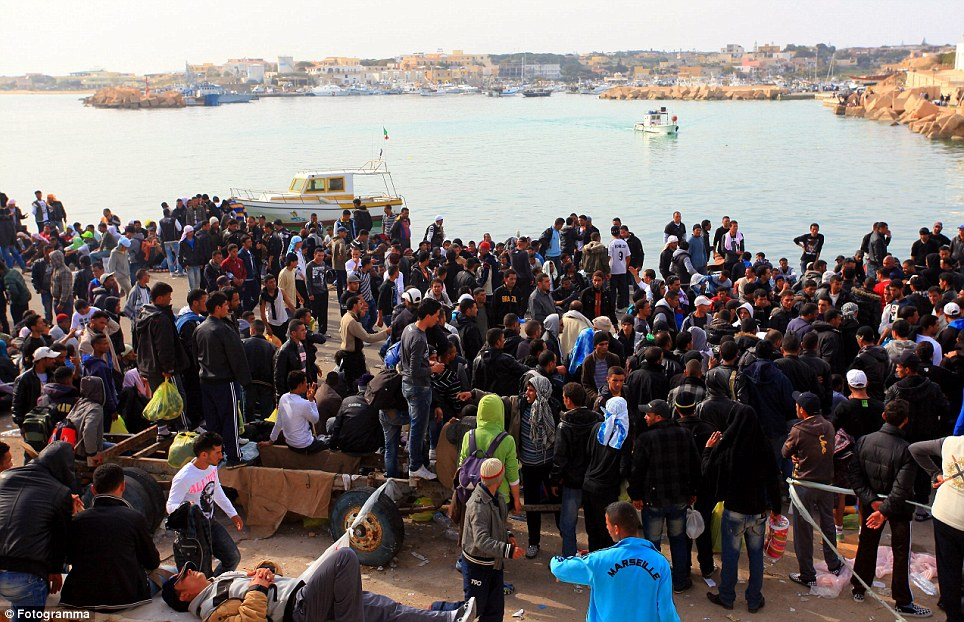 Protest: Hundreds of residents gather at the port to stop any more boats bearing refugees landing at Lampedusa