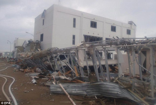 Scene of destruction: A building at the plant is surrounded by mangled metal girders that were damaged in the earthquake