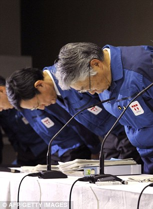 Apology: Tokyo Electric Power Co. chairman Tsunehisa Katsumata, right, finally admitted that the battle to save the plant had been lost and apologised for the 'trouble and anxiety' caused by the radiation leaks
