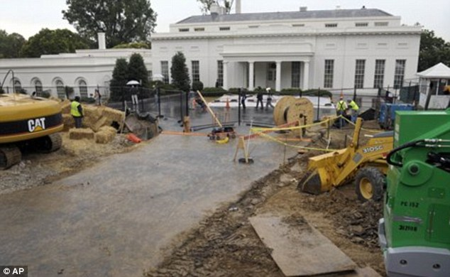 Under construction: Building works adjacent to the West Wing in 2010. The four-year project will see the front yard at 1600 Pennsylvania remain a noisy building site until 2014