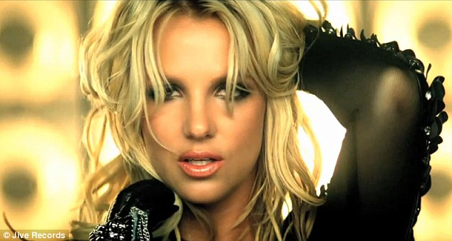 It's Britney, b**ch: The pop star tousles her blonde wavy hair as she sings seductively to the camera...