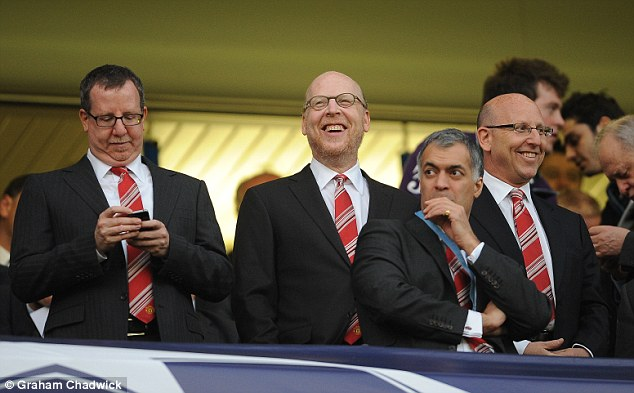 Money well spent: Bryan, Avram and Joel Glazer were in attendance at Stamford Bridge