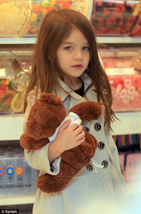 What shall I get this time? Suri Cruise visits Dylan's Candy Store in New York with her parents Tom Cruise and Katie Holmes
