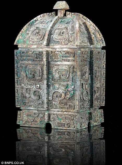 Expensive tipple: The ancient wine casks are being tipped to sell for a whopping £1million and £800,000 respectively. One of them, a rectangular fangyi vessel, dates back to the Chinese Shang dynasty between 1300 to 1050BC