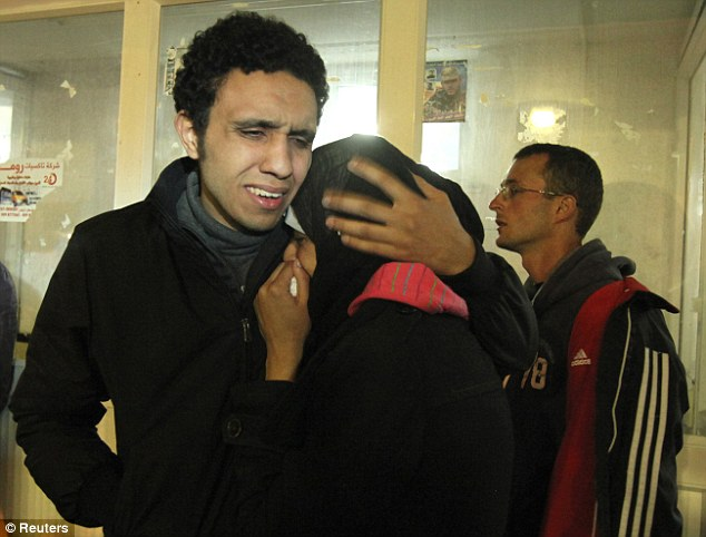 Distraught: Friends of Mr Arrigoni mourn at Al-Shifa hospital in Gaza city after hearing of his death