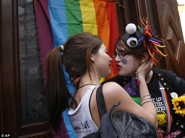 Liplock your way to protest discrimination against homosexuals. Pic courtesy: AP