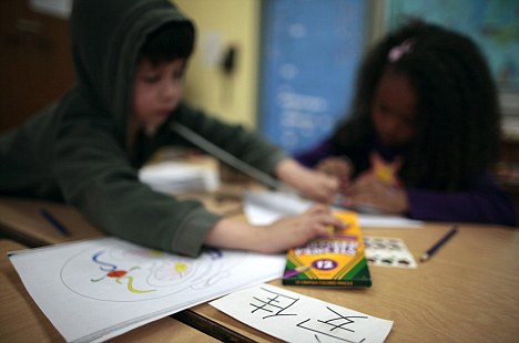 Children sit at desks marked with their name tags in Chinese at Broadway Elementary School in Venice, Los Angeles, which launched one of only two English-Mandarin Chinese dual-language immersion programmes in the Los Angeles Unified School District in 2010