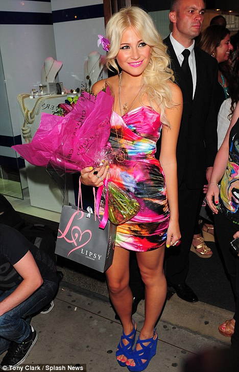 Party princess: The star of the evening then changed into a brightly coloured strapless minidress from her collection