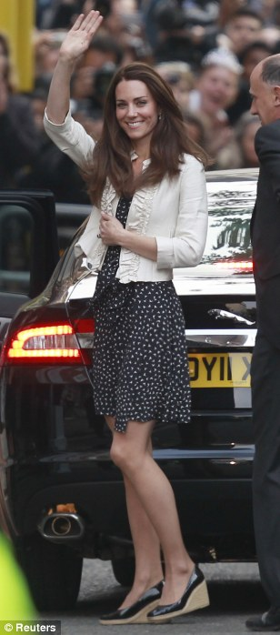 Kate Middleton waves to the crowds as she prepares to spend her final night as a single woman and a commoner