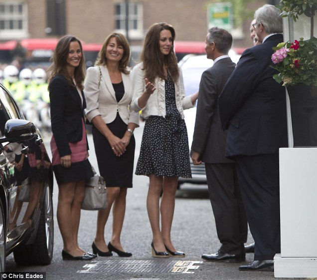 A family affair: Kate outside the Goring Hotel with her sister Pippa and mother Carole this evening
