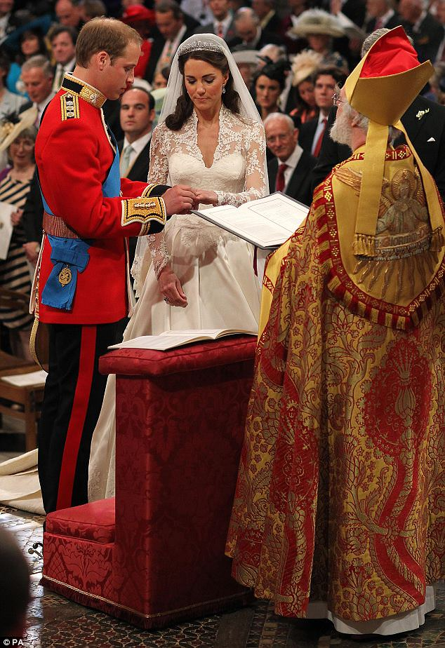 Prince William and Kate Middleton exchange rings in front of the Archbishop of Canterbury during the ceremony