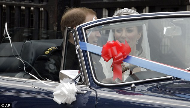Unexpected: William motors around Buckingham Palace with his new wife in his father's 38-year-old Aston Martin which he was given as a gift for his 21st birthday party