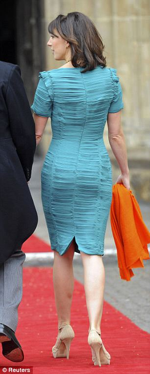 Chic: Samantha Cameron chose a vivid emerald sheath dress with elaborate pleats, said to be designed by Christopher Kane, accessorised with orange scarf, statement necklace and nude shoes - but the PM's wife left her head bare