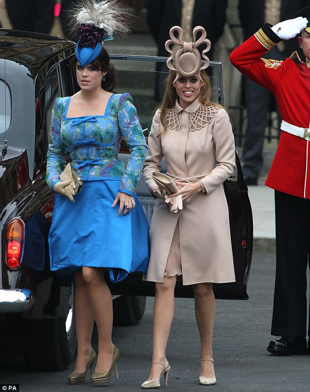 Oh dear: Princess Eugenie wore a blue Vivienne Westwood pouffy dress while her sister Beatrice chose a nude Valentino couture coat