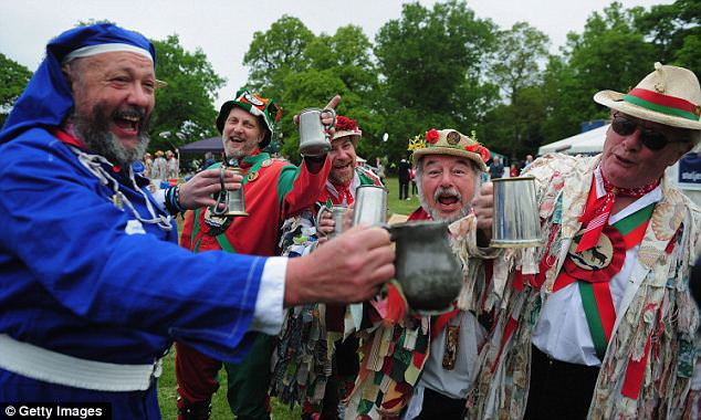 Full English: Morris Men, colourfully dressed in their traditional garb, raise a glass to the happy couple in Bucklebury