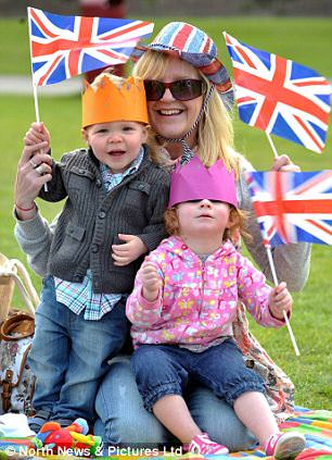 Family fun day: Noah King, 2, Heather Reed and Ava Reehal, 2, amongst the excited crowds watching the Royal Wedding between William and Kate on a big screen at Marine Park in South Shields, South Tyneside, as the country unites in celebration.