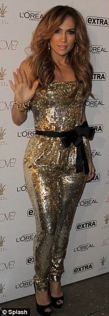 Dazzling: The singer and American Idol host sparkled in a gold sequin strapless jumpsuit with black pumps