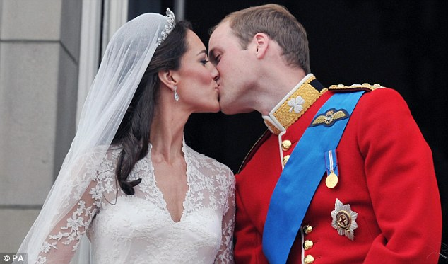 Sealed with a kiss: The couple, who have been given the titles Duke and Duchess of Cambridge, kiss on the balcony of Buckingham Palace